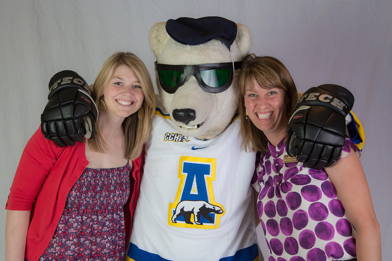 """UAF admissions counselors Caitlin Kaber, left, and Amy Bristor get a hug from a friend during an Inside Out event in the Wood Center ballroom.  <div class=""""ss-paypal-button"""">Filename: AAR-12-3470-38.jpg</div><div class=""""ss-paypal-button-end"""" style=""""""""></div>"""