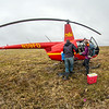 "Ph.D candidate Ludda Ludwig, right, helps unload a helicopter after a short flight from the Toolik Field Station to her research site near the headwaters of the Kuparuk River. Ludwig's study is focused on the movement of water and nutrients from Arctic hillslopes to streams. The Toolik research facility, located about 370 miles north of Fairbanks on Alaska's North Slope, is operated by UAF's Institute of Arctic Biology.  <div class=""ss-paypal-button"">Filename: AAR-14-4217-026.jpg</div><div class=""ss-paypal-button-end""></div>"