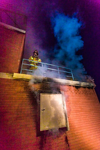 Student fire fighters with the UFD prepare to enter the second floor of a burning building during a live training drill at the Fairbanks Fire Training Center.  Filename: AAR-13-3978-87.jpg