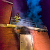"Student fire fighters with the UFD prepare to enter the second floor of a burning building during a live training drill at the Fairbanks Fire Training Center.  <div class=""ss-paypal-button"">Filename: AAR-13-3978-87.jpg</div><div class=""ss-paypal-button-end"" style=""""></div>"