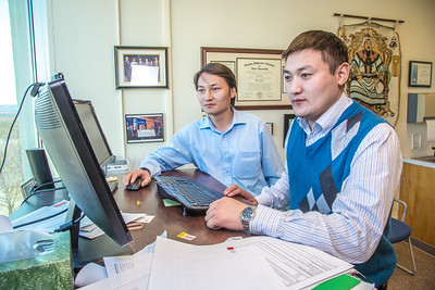 UAF graduate students Purevbaatar Narantsetseg, left, and Erdenebaatar Dondov, study hard rock mine design in a Duckering Building faculty office. The duo is part of a partnership between UAF and the Mongolian government to establish a school of mining engineering there to educate locals to help develop the country's mineral resources.  Filename: AAR-13-3842-46.jpg
