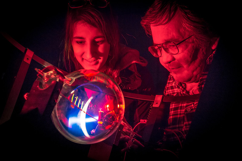 "Physics major Haley Nelson, left, and Stanley Edwin experiment with a device that creates an artificial aurora borealis in a Reichardt Building lab.  <div class=""ss-paypal-button"">Filename: AAR-13-4009-68.jpg</div><div class=""ss-paypal-button-end""></div>"