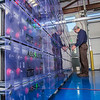 "Research technician David Light works with the battery bank in one of the modules in the Alaska Center for Energy and Power Technology Center.  <div class=""ss-paypal-button"">Filename: AAR-12-3479-053.jpg</div><div class=""ss-paypal-button-end"" style=""""></div>"
