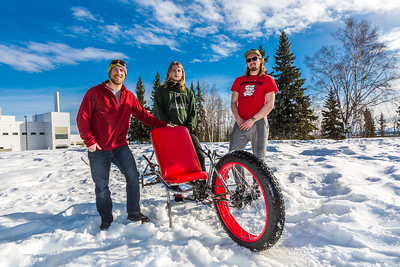Mechanical engineering majors Neil Gotschall, left, Daniel Sandstrom and Eric Bookless pose with their fat tire ski bike they designed and built for paraplegic users as their spring 2016 senior design project. The bike is powered by pushing and pulling on the handles.  Filename: AAR-16-4856-49.jpg