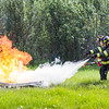 "Program coordinator and Associate Professor of Fire Science John George instructs cadets on the proper use of fire extinguishers during the 2016 Summer Fire Academy at the University Fire Department's station on University Avenue.  <div class=""ss-paypal-button"">Filename: AAR-16-4937-21.jpg</div><div class=""ss-paypal-button-end""></div>"