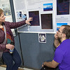 "Assistant Professor Erin Pettit, left, looks over Jason Thies' research poster days after his resturn from Antarctica during the Research Days poster session in the Wood Center.  <div class=""ss-paypal-button"">Filename: AAR-12-3363-09.jpg</div><div class=""ss-paypal-button-end"" style=""""></div>"
