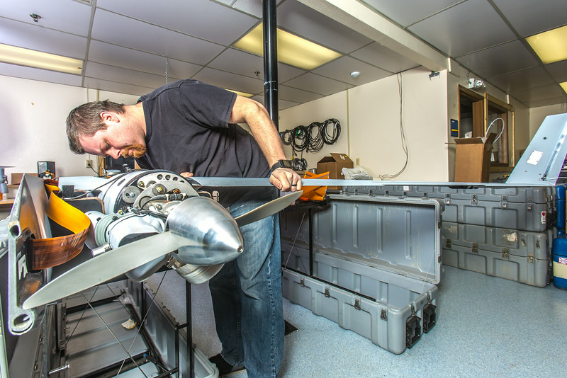 "Technician Michael Cook works on one of the unmanned aerial vehicles in UAF's Alaska Center for Unmanned Aircraft Systems Integration (ACUASI) shop in south Fairbanks.  <div class=""ss-paypal-button"">Filename: AAR-13-4026-135.jpg</div><div class=""ss-paypal-button-end""></div>"