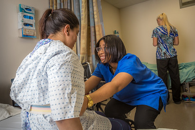 Chloe Gilbreath, right, and Laura Castro alternate practicing proper techniques for helping patients out of bed during an exercise in CTC's nursing assistant training at the program's facility on Barnette Street in downtown Fairbanks.  Filename: AAR-16-4873-230.jpg