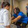 "Chloe Gilbreath, right, and Laura Castro alternate practicing proper techniques for helping patients out of bed during an exercise in CTC's nursing assistant training at the program's facility on Barnette Street in downtown Fairbanks.  <div class=""ss-paypal-button"">Filename: AAR-16-4873-230.jpg</div><div class=""ss-paypal-button-end""></div>"