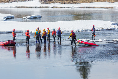 Staff members and graduate students from the Water and Environmental Research Center (WERC) and the Institute of Northern Engineering (INE) receive swiftwater rescue and safety training in the Chena River.  Filename: AAR-13-3813-79.jpg