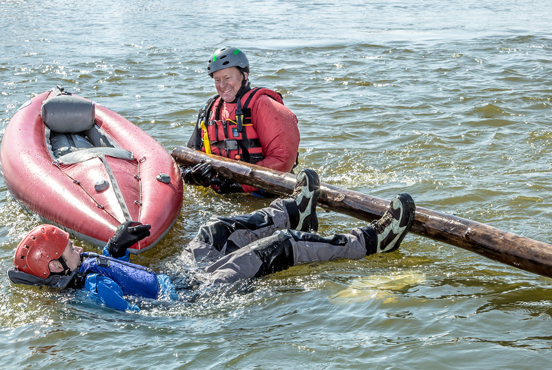 """Staff members and graduate students from the Water and Environmental Research Center (WERC) and the Institute of Northern Engineering (INE) receive swiftwater rescue and safety training in the Chena River.  <div class=""""ss-paypal-button"""">Filename: AAR-13-3813-116.jpg</div><div class=""""ss-paypal-button-end"""" style=""""""""></div>"""