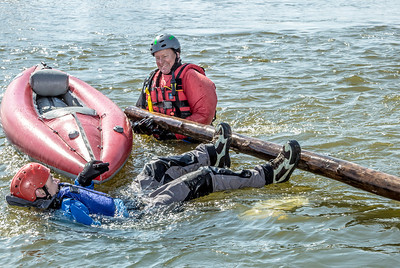 Staff members and graduate students from the Water and Environmental Research Center (WERC) and the Institute of Northern Engineering (INE) receive swiftwater rescue and safety training in the Chena River.  Filename: AAR-13-3813-116.jpg