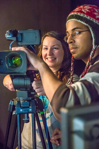 Naomi O'Neal and James Martinez focus on a scene while shooting during the 2013 Wintermester cinematography class in the UAF Fine Arts complex.  Filename: AAR-13-3690-21.jpg