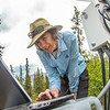 "Associate professor Margaret Darrow, reads data from a weather station installed on one of  several frozen debris lobes which have appeared along the Dietrich River valley in the southern Brooks Range. Darrow, along with state geologists Ron Daanen, and Trent Hubbard, are trying to figure out how to slow down or stop the movement of the lobes which threaten the Dalton Highway and the nearby trans-Alaska pipeline.  <div class=""ss-paypal-button"">Filename: AAR-14-4214-515.jpg</div><div class=""ss-paypal-button-end""></div>"