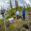 "Associate professor Margaret Darrow, left, consults with state geologists Ronald Daanen, left, and Trent Hubbard at a remote weather station installed on one of several frozen debris lobes which have appeared along the Dietrich River valley in the southern Brooks Range about 225 miles north of Fairbanks. The three are trying to figure out how to slow down or stop the movement of the lobes which threaten the Dalton Highway and the nearby trans-Alaska pipeline.  <div class=""ss-paypal-button"">Filename: AAR-14-4214-485.jpg</div><div class=""ss-paypal-button-end""></div>"