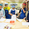 "Café Tween students receive their recipes before cooking Indian cuisine.  <div class=""ss-paypal-button"">Filename: AAR-12-3434-4.jpg</div><div class=""ss-paypal-button-end"" style=""""></div>"