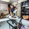 "Technician Michael Cook works on one of the unmanned aerial vehicles in UAF's Alaska Center for Unmanned Aircraft Systems Integration (ACUASI) shop in south Fairbanks.  <div class=""ss-paypal-button"">Filename: AAR-13-4026-146.jpg</div><div class=""ss-paypal-button-end""></div>"