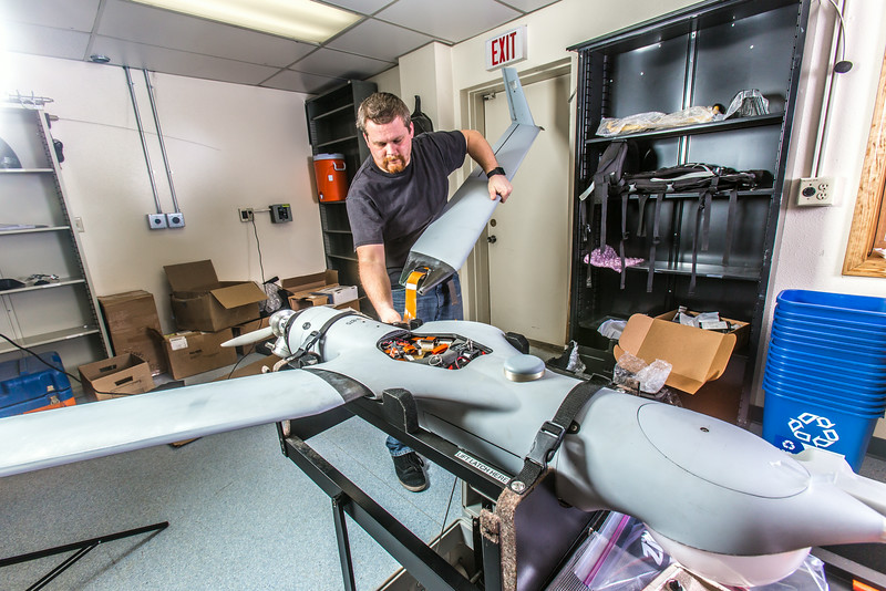 """Technician Michael Cook works on one of the unmanned aerial vehicles in UAF's Alaska Center for Unmanned Aircraft Systems Integration (ACUASI) shop in south Fairbanks.  <div class=""""ss-paypal-button"""">Filename: AAR-13-4026-146.jpg</div><div class=""""ss-paypal-button-end""""></div>"""