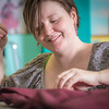 """Student employee and theatre major Stephanie Sandberg enjoys sewing as part of her job in the costume shop at Theatre UAF.  <div class=""""ss-paypal-button"""">Filename: AAR-14-4104-32.jpg</div><div class=""""ss-paypal-button-end"""" style=""""""""></div>"""