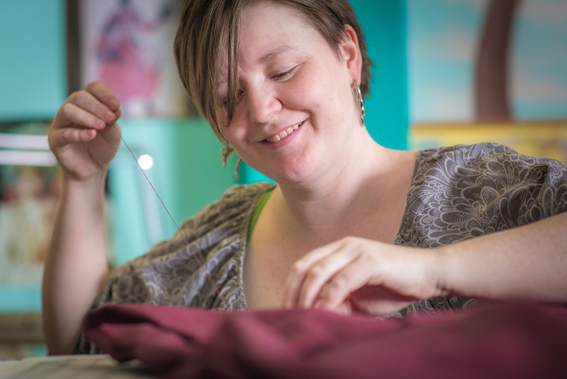 "Student employee and theatre major Stephanie Sandberg enjoys sewing as part of her job in the costume shop at Theatre UAF.  <div class=""ss-paypal-button"">Filename: AAR-14-4104-32.jpg</div><div class=""ss-paypal-button-end"" style=""""></div>"