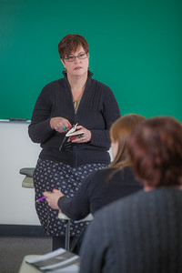 Professor Alexandra Fitts addresses students in her Hispanic Theater class during a recent meeting in the Gruening Building.  Filename: AAR-12-3350-14.jpg
