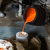 "Art major Joel Isaak fills a mold with molten bronze as part of the process of creating a life-sized sculpture for his senior thesis in the UAF Fine Arts complex.  <div class=""ss-paypal-button"">Filename: AAR-12-3347-100.jpg</div><div class=""ss-paypal-button-end"" style=""""></div>"