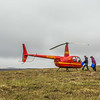 "Ph.D candidate Ludda Ludwig, right, helps load a helicopter before a short flight to the Toolik Field Station from her research site near the headwaters of the Kuparuk River. Ludwig's study is focused on the movement of water and nutrients from Arctic hillslopes to streams. The Toolik research facility, located about 370 miles north of Fairbanks on Alaska's North Slope, is operated by UAF's Institute of Arctic Biology.  <div class=""ss-paypal-button"">Filename: AAR-14-4217-123.jpg</div><div class=""ss-paypal-button-end""></div>"