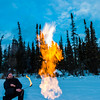 "Research Associate Professor Katey Walter Anthony and a research assistant set fire to escaping methane gas trapped beneath the ice on a pond on the UAF campus. The naturally occurring phenomenon is made worse by thawing permafrost and increased plant decay caused by global warming.  <div class=""ss-paypal-button"">Filename: AAR-16-4815-04.jpg</div><div class=""ss-paypal-button-end""></div>"