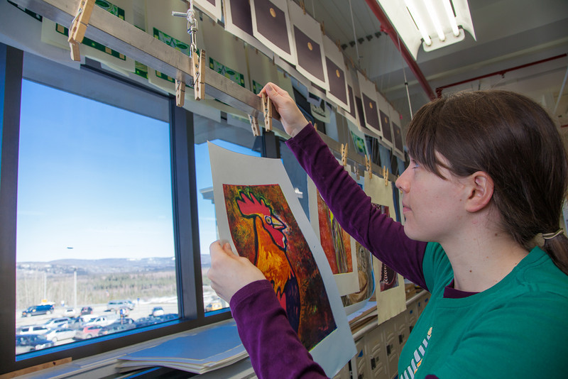 """Senior foreign languages major Lindsey Miller spent lots of time in the printmaking studio in the UAF Fine Arts Complex.  <div class=""""ss-paypal-button"""">Filename: AAR-12-3353-29.jpg</div><div class=""""ss-paypal-button-end"""" style=""""""""></div>"""