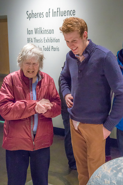 "Art major Ian Wilkinson visits with patrons during the opening reception of his BFA thesis in the gallery of the UAF Fine Arts Complex.  <div class=""ss-paypal-button"">Filename: AAR-13-3780-397.jpg</div><div class=""ss-paypal-button-end"" style=""""></div>"