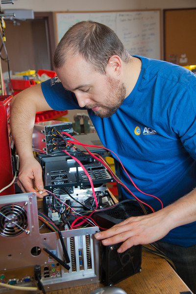 "Graduate student Richard Stevens works on components of a desktop computer in the workshop of the Alaska Center for Energy and Power on the Fairbanks campus.  <div class=""ss-paypal-button"">Filename: AAR-11-3245-45.jpg</div><div class=""ss-paypal-button-end"" style=""""></div>"