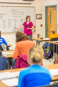 Amy Cooper lectures to her intermediate accounting students in a Duckering Building classroom.  Filename: AAR-14-4112-123.jpg