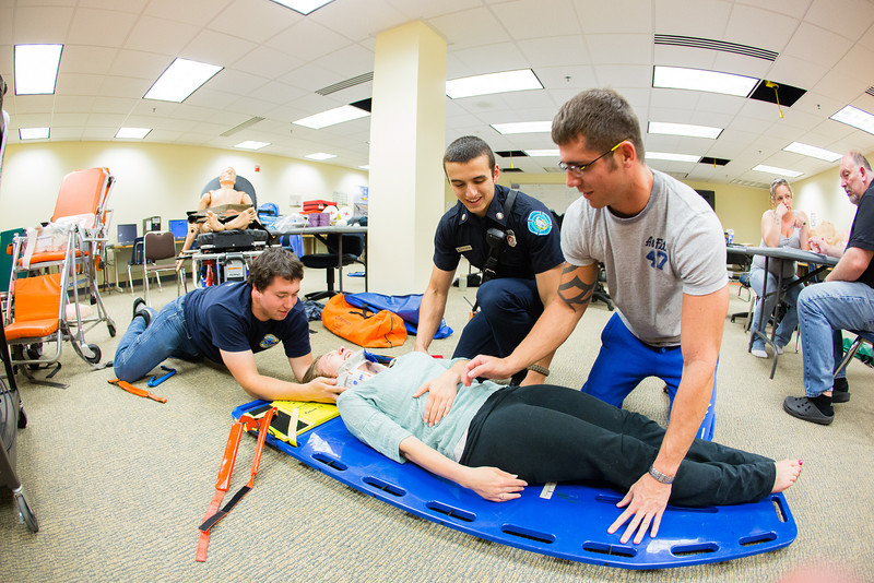 "EMT students from left: Quinten Johnson, Michael Bellia and Floyd Lewis provide medical attention for training purposes to fellow student Claire Todd during class at the UAF Community & Technical College.  <div class=""ss-paypal-button"">Filename: AAR-12-3444-7.jpg</div><div class=""ss-paypal-button-end"" style=""""></div>"