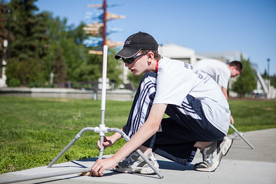 Middle school students try various rocket designs outdoors during the Alaska Summer Research Academy.  Filename: AAR-13-3862-20.jpg