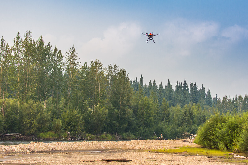 """An unmanned aerial vehicle (UAV) stands ready to collect video of important king salmon spawning habitat along a popular stretch of the upper Chena River about 40 miles northeast of Fairbanks. The project was a collaboration between the Alaska Center for Unmanned Aircraft Systems Integration (ACUASI) and the U.S. Fish and Wildlife Service.  <div class=""""ss-paypal-button"""">Filename: AAR-15-4593-348.jpg</div><div class=""""ss-paypal-button-end""""></div>"""