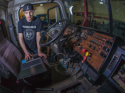 Jordan Young runs diagnostics on a big truck in the diesel mechanics lab at the Hutchison Institute of Technology.  Filename: AAR-12-3312-181.jpg