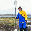 """Graduate student Levi Overbeck prepares to test a dry suit and raft paddling around Toolik Lake during his summer research season at the Toolik Field Station on Alaska's North Slope.  <div class=""""ss-paypal-button"""">Filename: AAR-14-4216-099.jpg</div><div class=""""ss-paypal-button-end""""></div>"""
