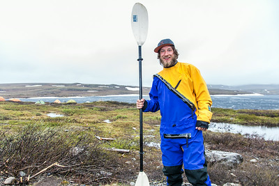Graduate student Levi Overbeck prepares to test a dry suit and raft paddling around Toolik Lake during his summer research season at the Toolik Field Station on Alaska's North Slope.  Filename: AAR-14-4216-099.jpg