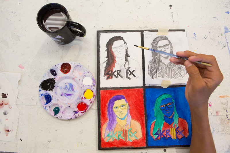 """A Visual Arts Academy student completes a painting at the Fine Arts Complex on the Fairbanks campus.  <div class=""""ss-paypal-button"""">Filename: AAR-16-4917-150.jpg</div><div class=""""ss-paypal-button-end""""></div>"""