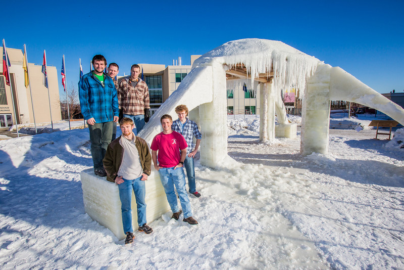 """Engineering students pose by the 2014 ice arch they designed and built on the Fairbanks campus -- a tradition dating back to the 1950s. From left to right are Daniel Hjortstorp,  Tux Seims, Vincent Valenti, Andy Chamberlain, Richard """"Buzz"""" Ward and James """"Tripp"""" Collier.  <div class=""""ss-paypal-button"""">Filename: AAR-14-4093-29.jpg</div><div class=""""ss-paypal-button-end"""" style=""""""""></div>"""