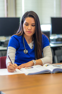 Pre-nursing student Tiffany Scott studies in a computer lab at UAF's Chukchi Campus in Kotzebue.  Filename: AAR-16-4863-466.jpg