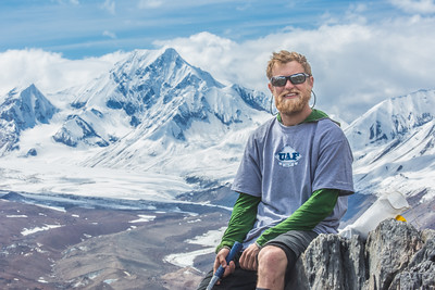 Undergraduate geology major Pat Terhune poses near his camp above the Chedotlothna Glacier on June 28 during a 15-day field trip researching complexities of the Denali fault in Denali National Park and Preserve.  Filename: AAR-14-4226-393.jpg