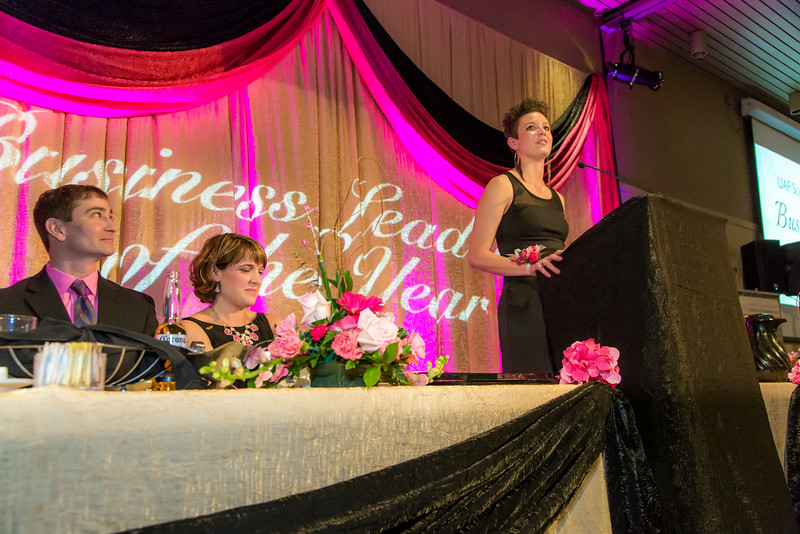 """Jacqueline Lovato, vice president of UAF's Associated Students of Business, addresses the audience during the annual SOM Business Leader of the Year banquet, honoring this year's winner Lorna Shaw.  <div class=""""ss-paypal-button"""">Filename: AAR-14-4154-213.jpg</div><div class=""""ss-paypal-button-end""""></div>"""