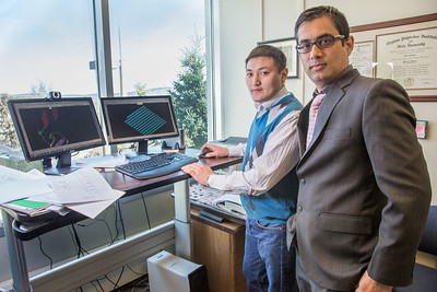 Prof. Rajive Ganguli, right, works with mineral engineering graduate student Erdenebaatar Dondov to study software models of mining design in his Duckering Building office. Ganguli is helping Dondov and the government in his home country of Mongolia to establish a school of mining engineering there to educate locals to help develop the country's mineral resources.  Filename: AAR-13-3842-15.jpg