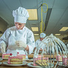 "Stephanie Valentik applies fresh berries to a batch of raspberry tarts being served during lunch at CTC's culinary arts kitchen in the Hutchison Center.  <div class=""ss-paypal-button"">Filename: AAR-13-3811-162.jpg</div><div class=""ss-paypal-button-end"" style=""""></div>"