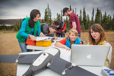 Students take part in a project using unmaned aerial vehicles (UAVs) at Poker Flat Research Range about 40 miles northeast of the Fairbanks campus. (Note: Taken as part of commercial shoot with Nerland Agency. Pretend class -- use with discretion!)  Filename: AAR-12-3560-040.jpg