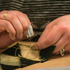 """Local residents learn traditional arts and crafts such as beading and skin sewing at UAF's Kuskokwim Campus in Bethel.  <div class=""""ss-paypal-button"""">Filename: AAR-16-4859-574.jpg</div><div class=""""ss-paypal-button-end""""></div>"""