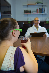 Psychology major Omar Rutledge administers a cognitive recognition test to a volunteer as part of his research to determine the effects of artificial sweeteners being used in a variety of popular drinks.  Filename: AAR-12-3328-85.jpg