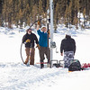 "Associate Professor Mat Wooller, blue shirt, and Ph.D. candidate Jim Shobe, left, test a new vibra-coring system through a hole in lake ice to sample long cores of sediment deep below the lake's bottom. Also helping is Terry Smith, right, a North Pole High School student intern.  <div class=""ss-paypal-button"">Filename: AAR-12-3346-026.jpg</div><div class=""ss-paypal-button-end"" style=""""></div>"