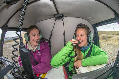 Ph.D candidate Ludda Ludwig, left, and Kelsey Blake, a graduate student from the University of Victoria in British Columbia, set off from the Toolik Field Station in a helicopter to gather data for Ludwig's study on movement of water and nutrients from Arctic hillslopes to streams. The facility, located about 370 miles north of Fairbanks on Alaska's North Slope, is operated by UAF's Institute of Arctic Biology.  Filename: AAR-14-4217-009.jpg